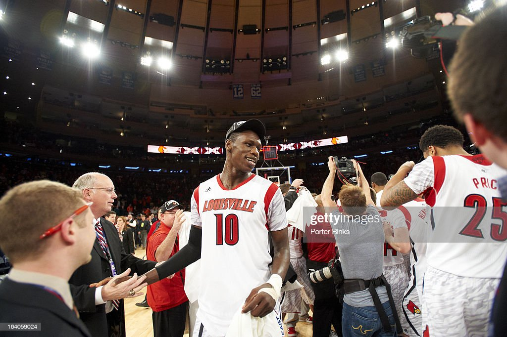 Louisville Gorgui Deng (10) victorious with teammates after winning game vs Syracuse during Finals at Madison Square Garden. Porter Binks F63 )
