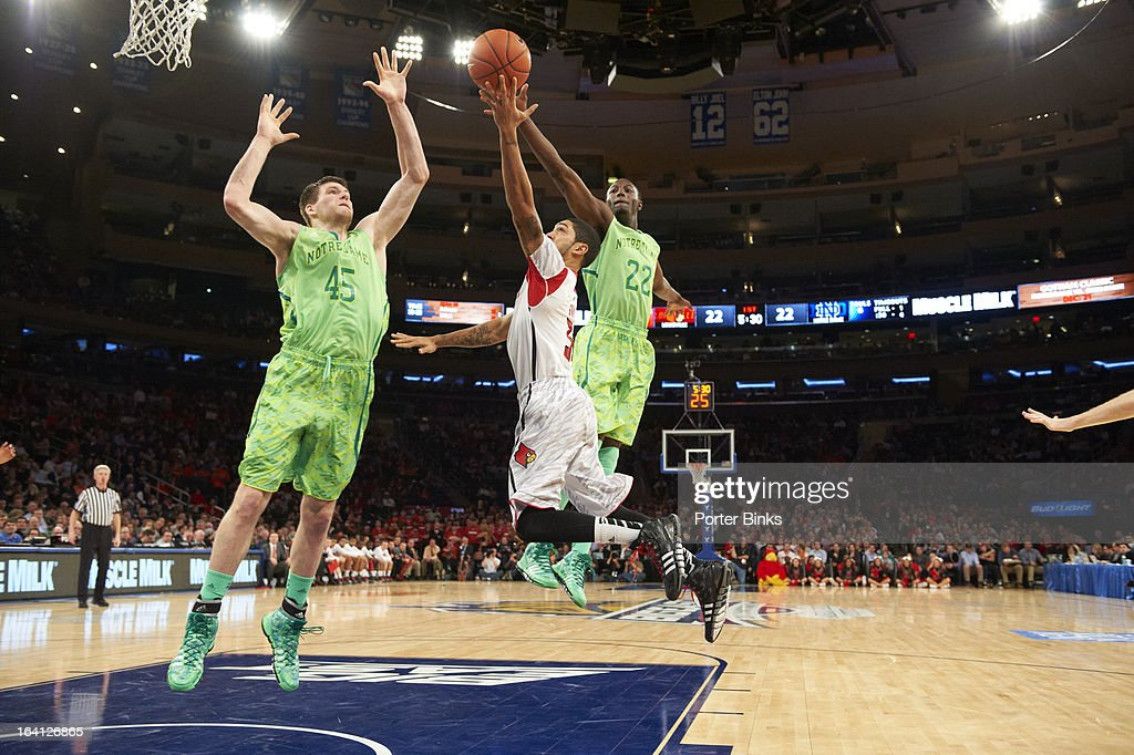 Louisville Gorgui Dieng (10) in action vs Notre Dame Jack Cooley (45) during Semifinal game at Madison Square Garden. Porter Binks F1 )