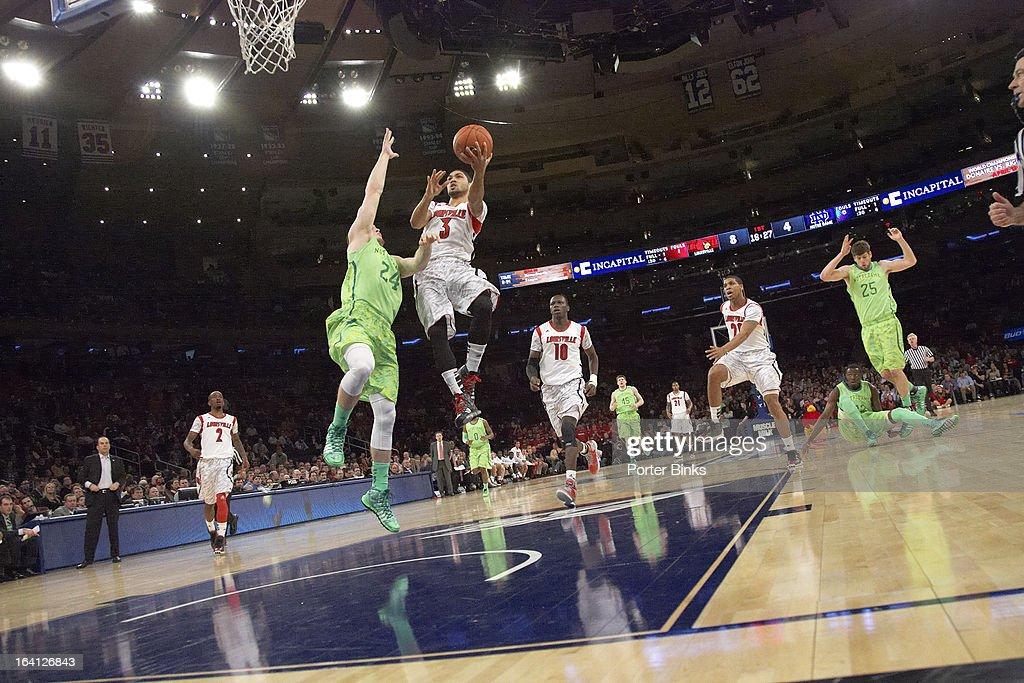 Louisville Peyton Siva (3) in action vs Notre Dame during Semifinal game at Madison Square Garden. Porter Binks F3 )
