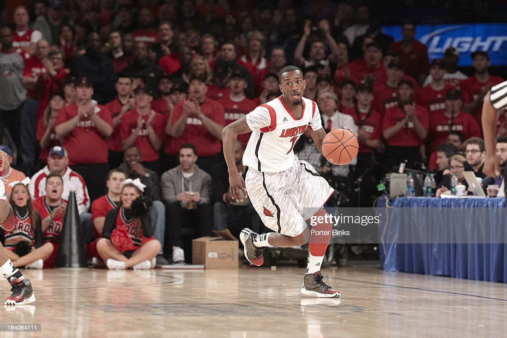 Louisville Russ Smith (2) in action vs Syracuse during Finals at Madison Square Garden. Porter Binks F127 )
