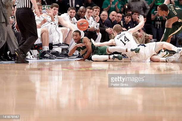 Big East Tournament South Florida Anthony Collins in action diving for loose ball vs Notre Dame Scott Martin during Quarterfinals game at Madison...