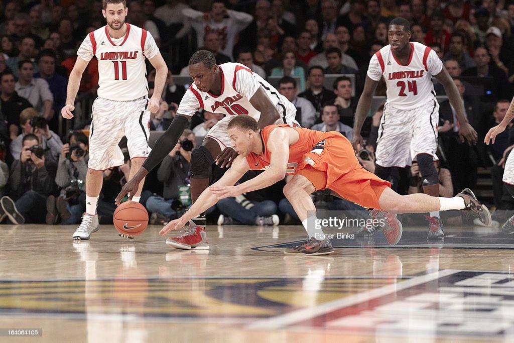 Syracuse Brandon Triche (20) in action vs Louisville Gorgui Dieng (10) during Finals at Madison Square Garden. Porter Binks F123 )
