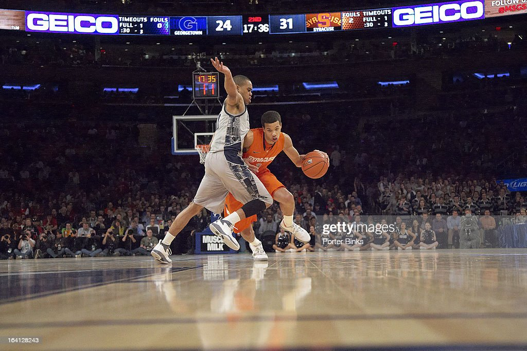 Syracuse Michael Carter-Williams (1) in action vs Georgetown during Semifinal game at Madison Square Garden. Porter Binks F18 )