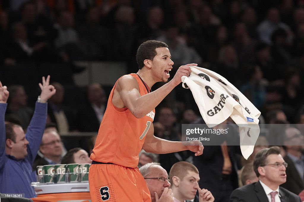 Syracuse Michael Carter-Williams (1) victorious during Semifinal game vs Georgetown at Madison Square Garden. Porter Binks F60 )