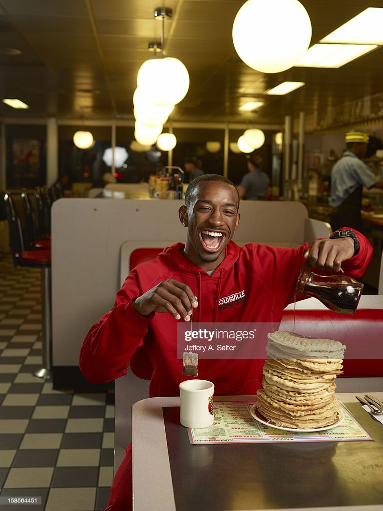 Casual portrait of Louisville Russ Smith posing while drinking tea and eating waffles during photo shoot at Waffle House on 4706 Preston Highway. Jeffery A. Salter F66 )