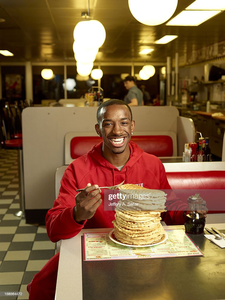 Casual portrait of Louisville Russ Smith posing while eating waffles during photo shoot at Waffle House on 4706 Preston Highway. Jeffery A. Salter F102 )