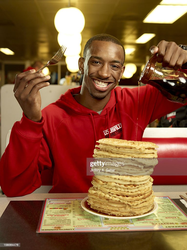 Casual portrait of Louisville Russ Smith posing while eating waffles during photo shoot at Waffle House on 4706 Preston Highway. Jeffery A. Salter F153 )
