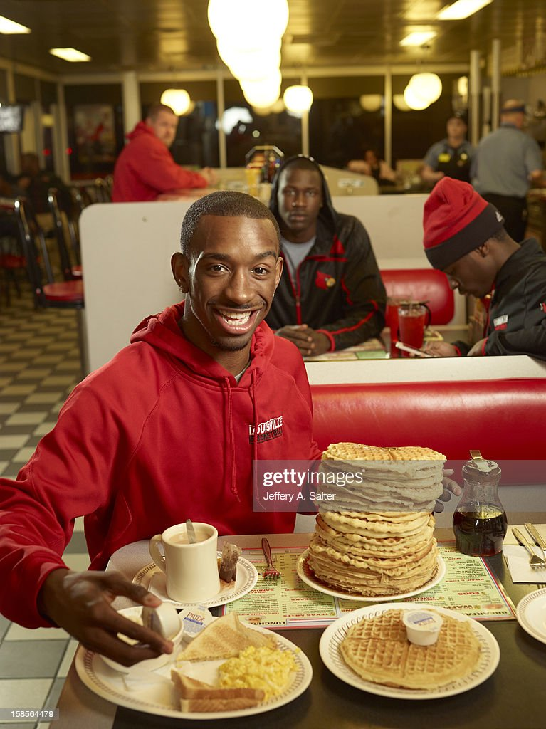 Casual portrait of Louisville Russ Smith posing while drinking tea and eating waffles during photo shoot at Waffle House on 4706 Preston Highway. Jeffery A. Salter F166 )