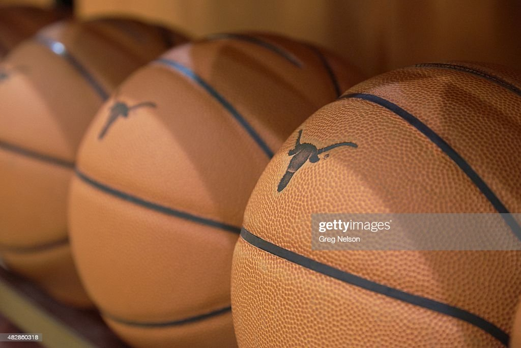 Closeup of balls with Texas Longhorns logo on rack during workout on Dozier Court practice facility in Cooley Pavilion Equipment Austin TX 6/22/2015...