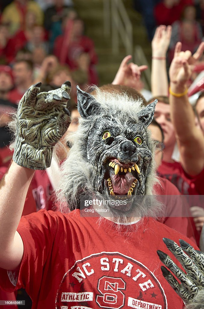 Closeup of North Carolina State fan wearing wolf mask in stands during game vs Miami at PNC Arena. Greg Nelson F44 )