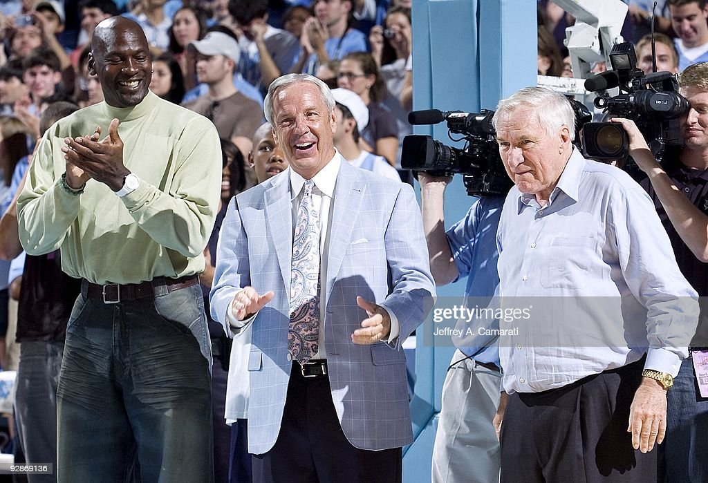 Former NBA basketball player Michael Jordan North Carolina head coach Roy Williams and former head coach Dean Smith during introductions before North...