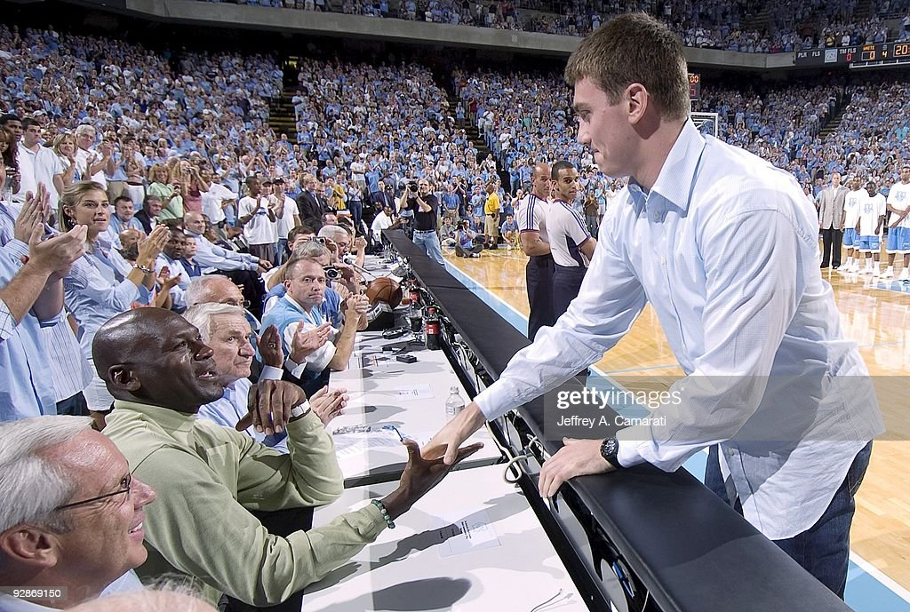 Indiana Pacers Tyler Hansbrough shakes hands with former NBA basketball player Michael Jordan before North Carolina Alumni Game at Dean Smith Center...