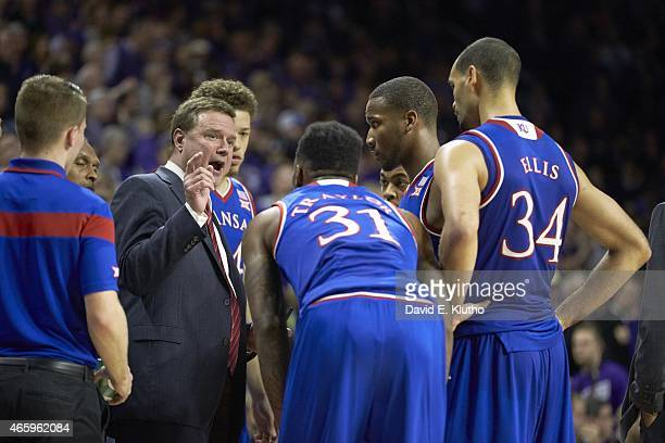 Kansas coach Bill Self in huddle with players during timeout during game vs Kansas State at Bramlage Coliseum Manhattan KS CREDIT David E Klutho