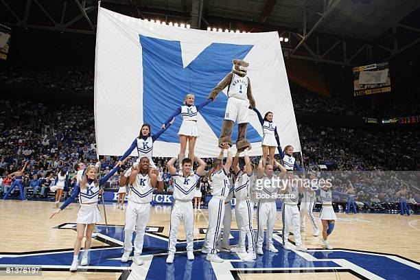 College Basketball Kentucky Wildcats mascot in action making pyramid with cheerleaders during game vs Kansas Lexington KY 1/9/2005