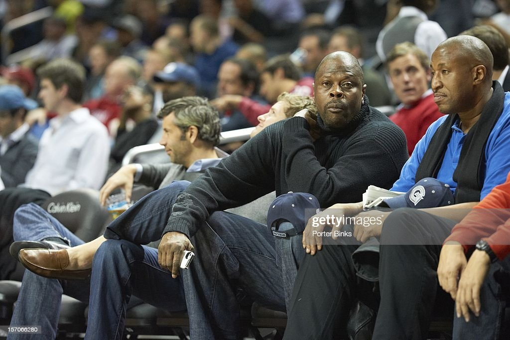 Former Georgetown players Patrick Ewing (L) and Ralph Dalton during game vs UCLA at Barclays Center. Porter Binks F494 )