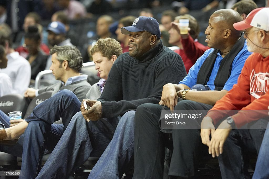 Former Georgetown players Patrick Ewing (L) and Ralph Dalton during game vs UCLA at Barclays Center. Porter Binks F456 )