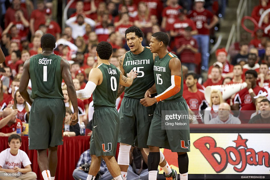 Miami Julian Gamble (45) with Durand Scott (1), Shane Larkin (0) and Rion Brown (15) during game vs North Carolina State at PNC Arena. Greg Nelson F10 )