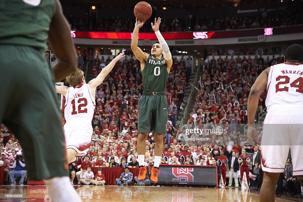 Miami Shane Larkin (0) in action, shooting vs North Carolina State at PNC Arena. Greg Nelson F73 )