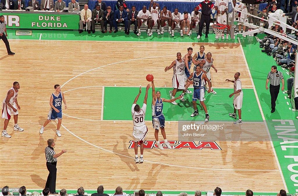 NCAA Final Four, Aerial view of Arkansas Scotty Thurman (30) in action, taking game winning three point shot vs Duke Antonio Lang (21), Charlotte, NC 4/4/1994