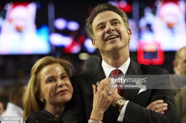 NCAA Final Four Closeup of Louisville head coach Rick Pitino victorious with his wife Joanne Minardi after winning game vs Michigan at Georgia Dome...