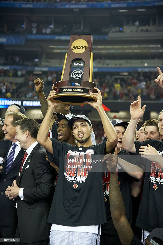 Closeup of Louisville Peyton Siva (3) victorious with NCAA Championship trophy after winning game vs Michigan at Georgia Dome. David E. Klutho X156381 TK1 R1 F6 )