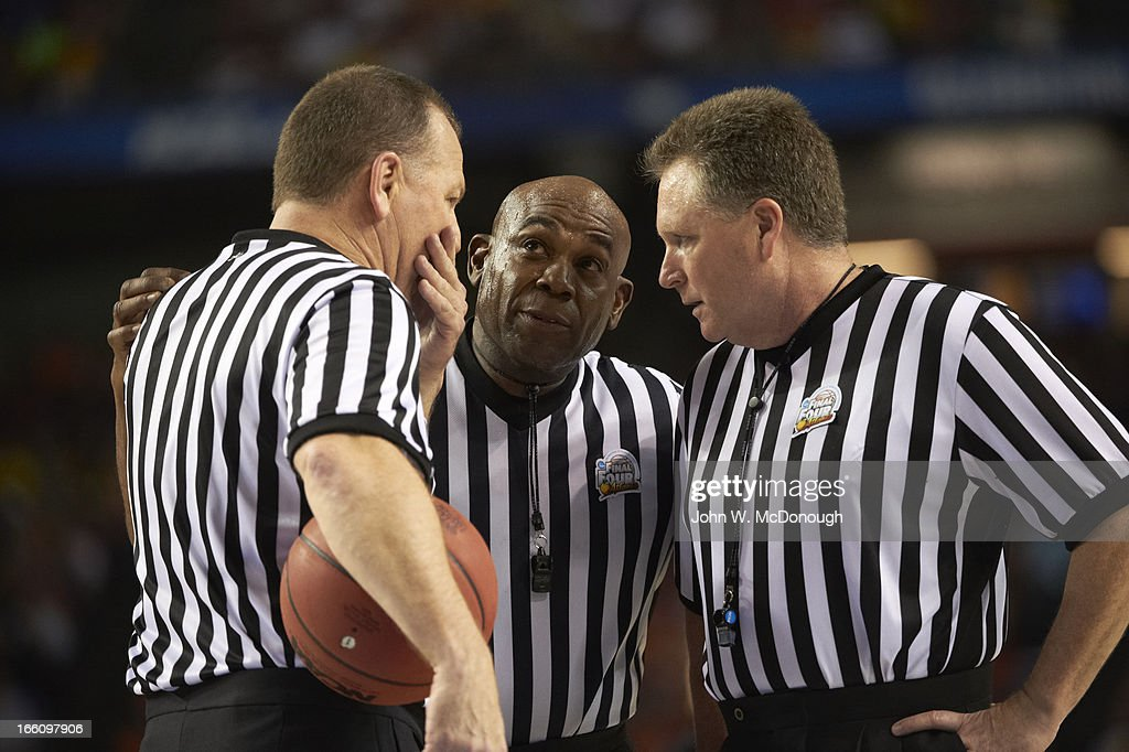 Closeup of NCAA referees Terry Wymer, Les Jones, and Karl Hess during Louisville vs Wichita State game at Georgia Dome. John W. McDonough X156344 TK1 R8 F27 )