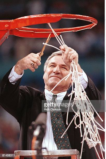 College Basketball NCAA Final Four Closeup of North Carolina coach Dean Smith victorious cutting down net after winning championship game vs Michigan...