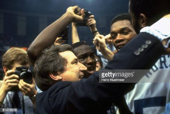 College Basketball NCAA Final Four Closeup of North Carolina coach Dean Smith victorious with James Worthy Sam Perkins and Michael Jordan after...