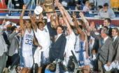 College Basketball NCAA Final Four Duke Coach Mike Krzyzewski victorious with team and trophy during celebration after winning championship game vs...
