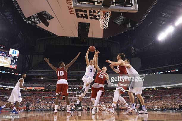 NCAA Final Four Duke Grayson Allen in action layup vs Wisconsin Sam Dekker at Lucas Oil Stadium Indianapolis IN CREDIT Greg Nelson