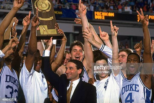 NCAA Final Four Duke head coach Mike Krzyzewski Christian Laettner Bobby Hurley and teammates victorious with trophy after winning National...