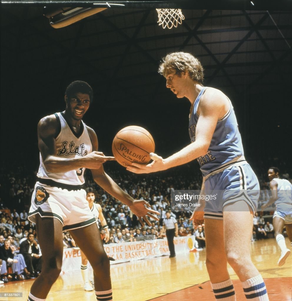College Basketball NCAA Final Four Indiana State Larry Bird handing ball to Michigan State Magic Johnson during championship game Salt Lake City UT...