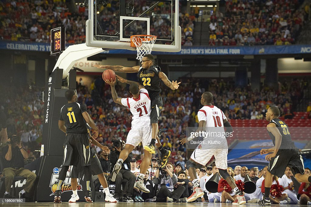 Louisville Chane Behanan (21) in action, layup vs Wichita State Carl Hall (22) at Georgia Dome. David E. Klutho X156343 TK1 R4 F12 )