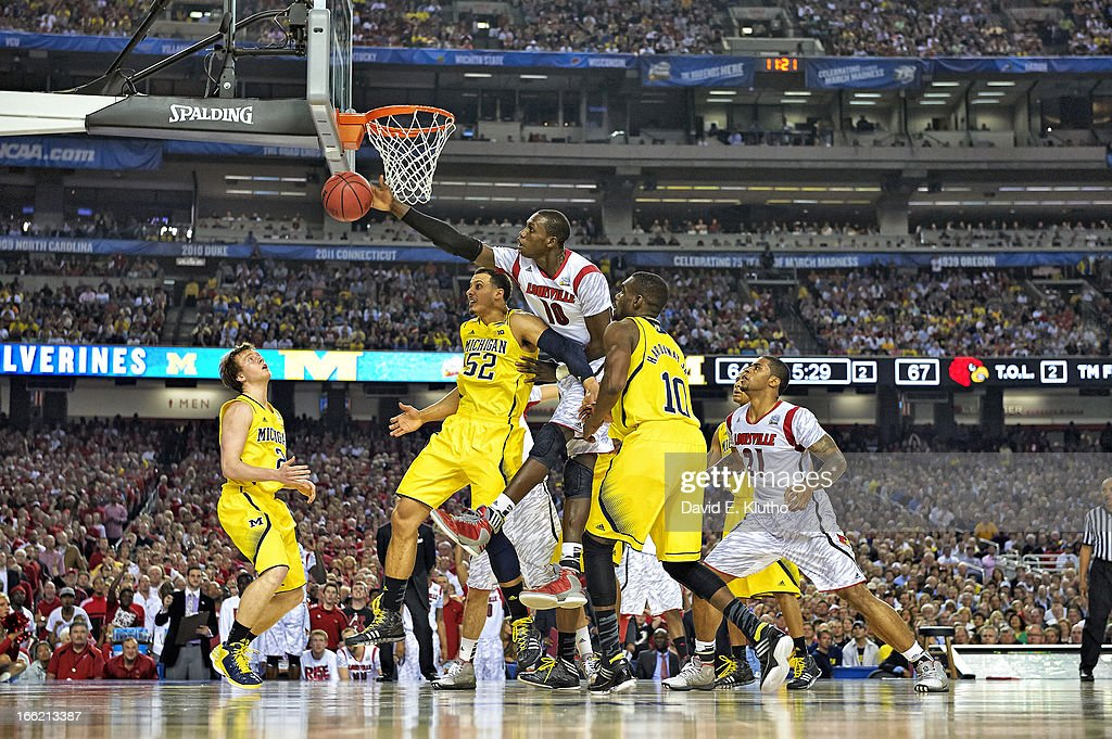 Louisville Gorgui Dieng (10) in action, defense vs Michigan at Georgia Dome. David E. Klutho X156381 TK1 R2 F93 )