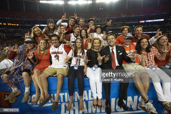 NCAA Final Four Louisville head coach Rick Pitino victorious with his wife Joanne Minardi and fans after winning game vs Michigan at Georgia Dome...