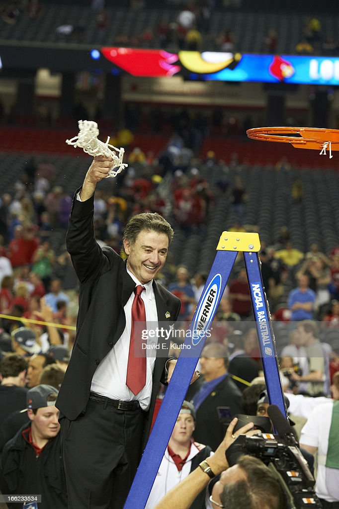Louisville head coach Rick Pitino victorious cutting down the net, after winning game vs Michigan at Georgia Dome. David E. Klutho F57 )
