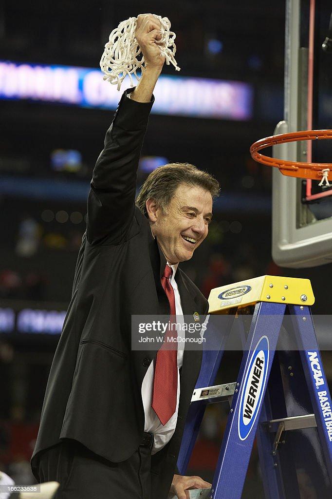 Louisville head coach Rick Pitino victorious cutting down the net, after winning game vs Michigan at Georgia Dome. John W. McDonough X156382 TK1 R1 F11 )