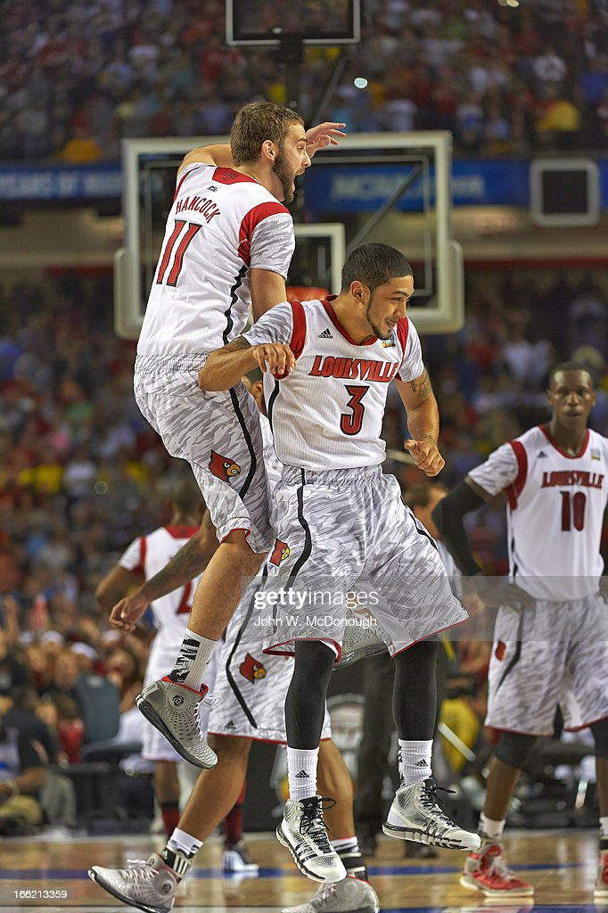 Louisville Peyton Siva (3) and Luke Hancock (11) victorious during game vs Michigan at Georgia Dome. Cover. John W. McDonough F203 )