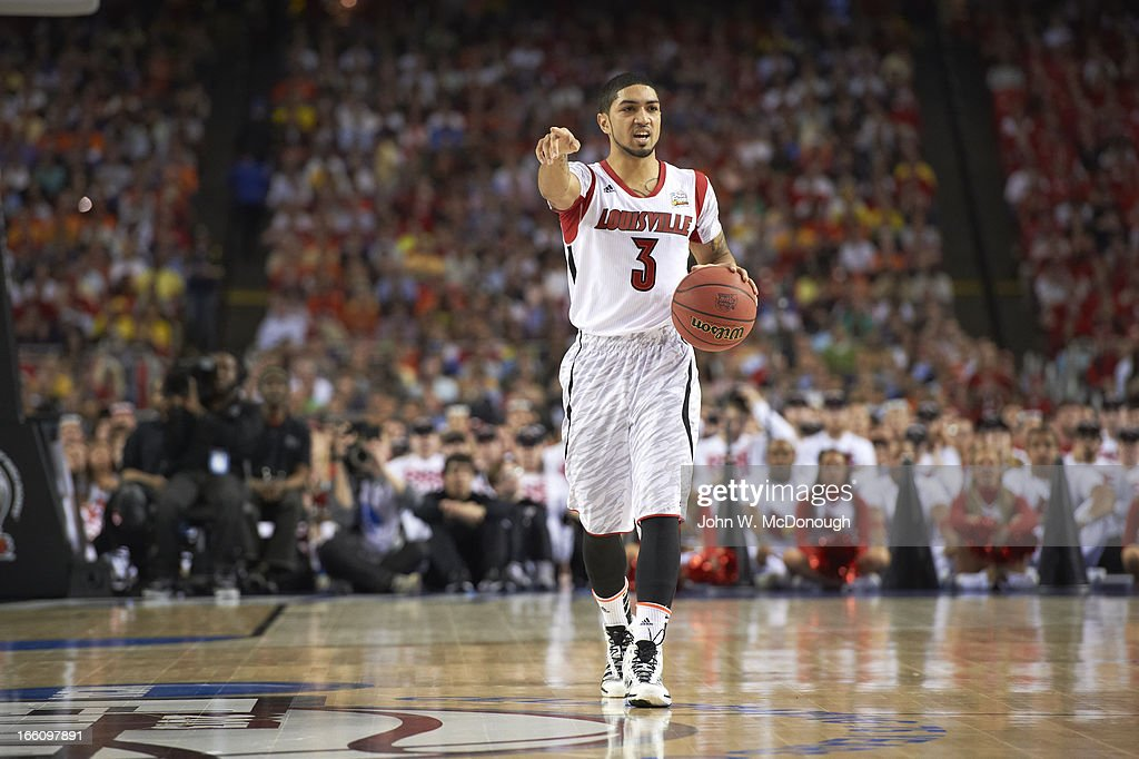 Louisville Peyton Siva (3) in action vs Wichita State at Georgia Dome. John W. McDonough X156344 TK1 R7 F64 )
