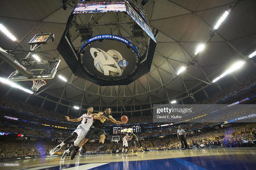 Louisville Peyton Siva (3) in action, defense vs Wichita State Tekele Cotton (32) at Georgia Dome. David E. Klutho X156343 TK1 R3 F171 )