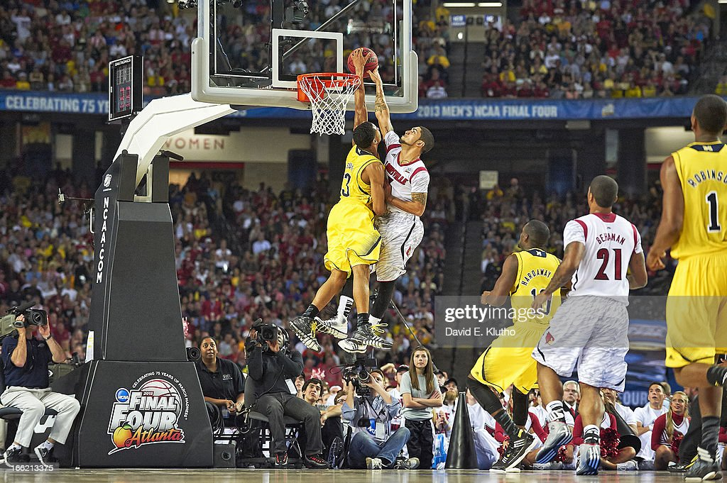 Louisville Peyton Siva (3) in action, taking foul from Michigan Trey Burke (3) at Georgia Dome. David E. Klutho X156381 TK1 R1 F71 )