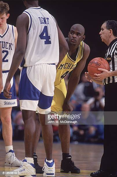 College Basketball NCAA Final Four Michigan Chris Webber with referee Gerry Donaghy during game vs Kentucky New Orleans LA 4/3/1993