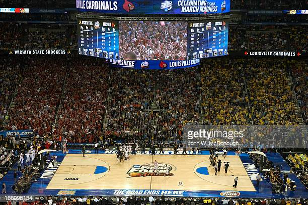 NCAA Final Four Overall view of Louisville fans victorious on court and on video screen after winning game vs Wichita State at Georgia Dome Atlanta...