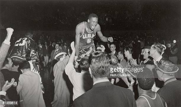 College Basketball NCAA Final Four San Francisco Bill Russell victorious getting carried off court by fans after winning championship game vs LaSalle...