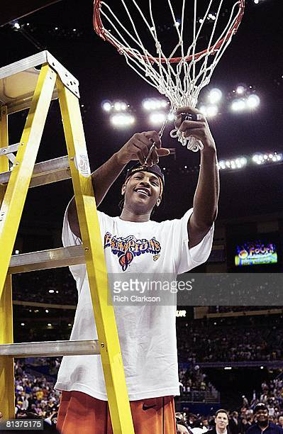 College Basketball NCAA Final Four Syracuse Carmelo Anthony victorious cutting down net after winning championship game vs Kansas New Orleans LA...