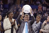 NCAA Final Four UConn coach Geno Auriemma victorious with NCAA/WBCA Coaches' Trophy after winning championship game vs Notre Dame at Amalie Arena...