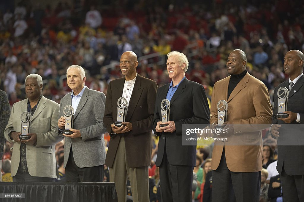View of former players Oscar Robertson, Jerry Lucas, Kareem Abdul-Jabbar, Bill Walton, Patrick Ewing, and Danny Manning on court to receive awards for Top 15 All-Time March Madness Players during Michigan vs Syracuse game at Georgia Dome. John W. McDonough X156344 TK2 R15 F63 )