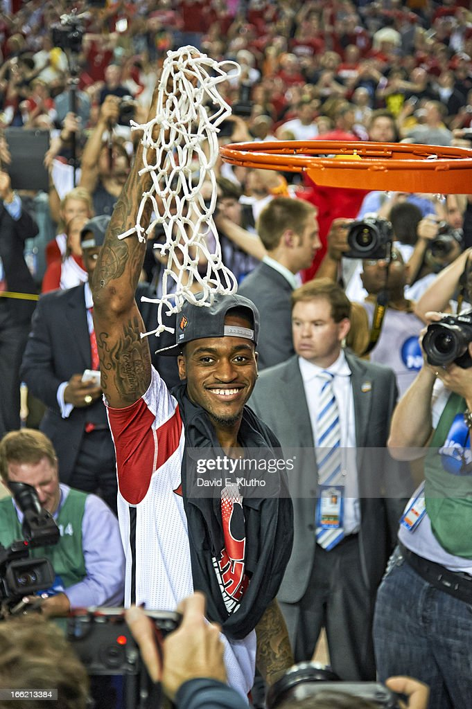 View of injured Louisville Kevin Ware (5) victorious, cutting down net after winning National Championship vs Michigan at Georgia Dome. Ware suffered a compound fracture injury to his right leg during the tournament. David E. Klutho X156381 TK1 R2 F51 )