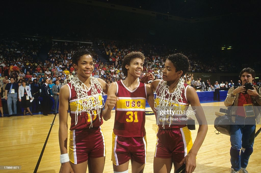 View of USC Paula McGee (11), Cheryl Miller (31) and Pamela McGee (30) victorious after winning championship game and cutting down nets vs Tennessee at Pauley Pavilion. Peter Read Miller X29808 TK3 )