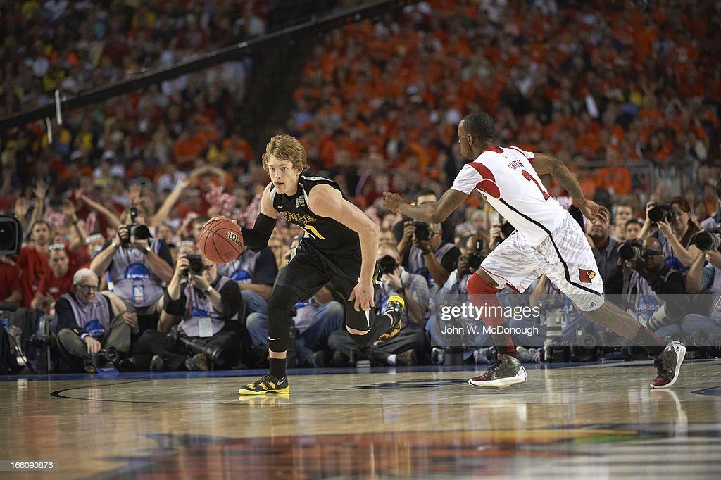 Wichita State Ron Baker (31) in action vs Louisville Russ Smith (2) at Georgia Dome. John W. McDonough X156344 TK1 R2 F124 )